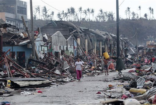 Residents walk past the devastation caused by Typhoon Haiyan, Sunday, Nov. 10, 2013, in Daanbantayan town, north Cebu, central Philippines. Typhoon Haiyan, one of the most powerful storms on record, slammed into six central Philippine islands on Friday, leaving a wide swath of destruction and scores of people dead. AP Photo/Chester Baldicantos/ Taken from: Philstar.com